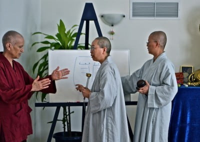 The Chinese nuns give us tips on our chanting practice.