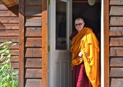 Venerable Tsultrim exits the Meditation Hall.