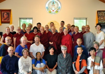 The Medicine Buddha Retreat participants pose for a group photo in the Chenrezig Hall Dining Room.