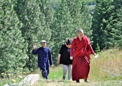 After a group discussion, Venerable Jampa leads her group of two up the path and back to the meditation hall.