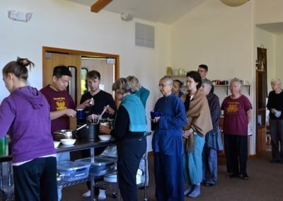 Guests line both sides of the buffet table, securing the nourishment needed for a good retreat.
