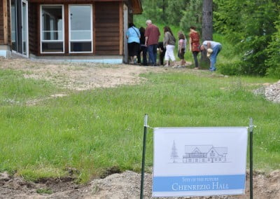 One of the tours enters the Meditation Hall up the hill from the future site of Chenrezig Hall.