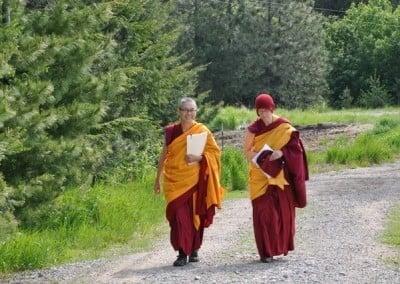 Buddhist nun, Venerable Tarpa walking with Ven Tenzin Kacho along one of the Abbey paths