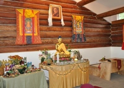 A buddha altar and offering in Abbey Meditation Hall.