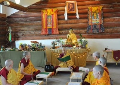 The Abbey bhikshuni sangha perform the posadha and recite the monastic precepts together in front of the Buddha altar.