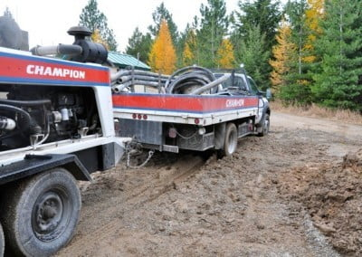 The small pump truck is mired in the mud.