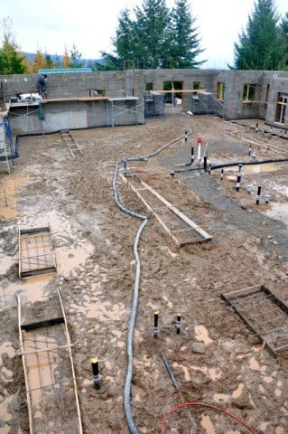 Inside structure of the construction site with muddy floors.