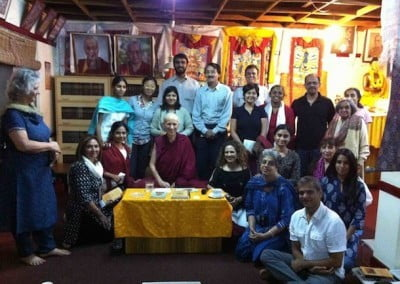 Group photo of Buddhist nun Venerable Chodron posing with men and women.