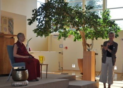 Sarah Conover introduces Ven. Chodron at the recent International Bhikunni Day celebration in Spokane.