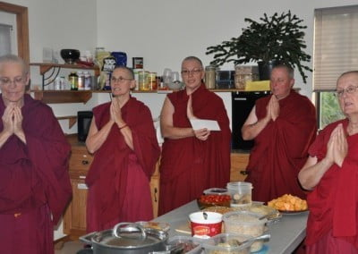 The participants make a food offering to the sangha and the sangha responds.
