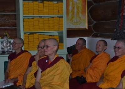 The sangha enjoy listening to the enthusiastic sharing of others.