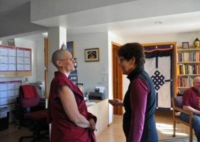 Buddhist nun, Venerable Chonyi talking to a woman.