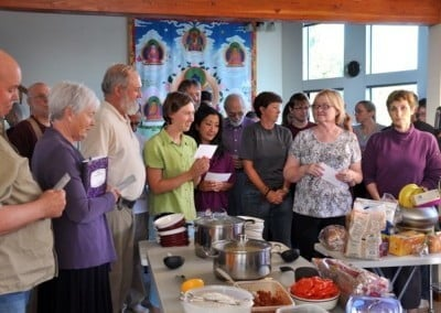 Guests to the retreat recite the prayer for offering food to the sangha.