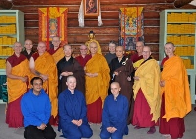 Group photo of abbey community, chinese nuns, anagarikas, a man and a woman.