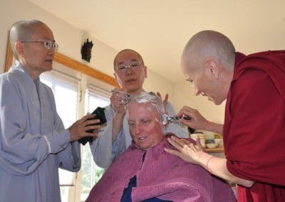 The hair shaving—symbolic of giving up attachment, anger, and confusion as well as attachment to our appearance—is done by the bhikshunis.
