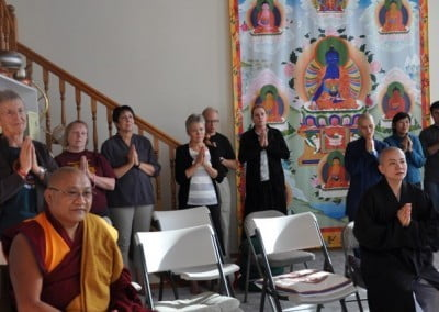 Geshe Phelgye and other Abbey friends chant during the head shaving ceremony.