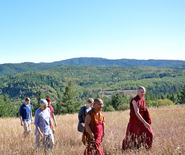 Monks, nuns, and guests out for a walk.