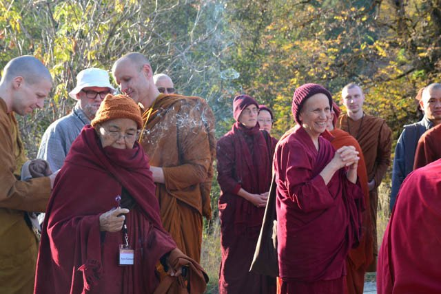 The monastics light incense before the land-blessing ceremony.