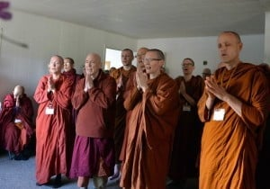 Theravada monastics chant their blessings.