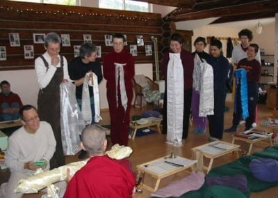 Participants make traditional final offerings of long khatas (scarves) and receive blessings at the end of the ceremony.