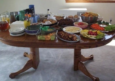 A table full of prepared food offered for the event.