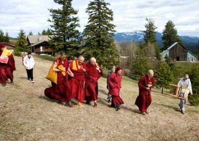 The Abbey community and our guests accompany Rinpoche to the site of the monastic residence located in the lower meadow.