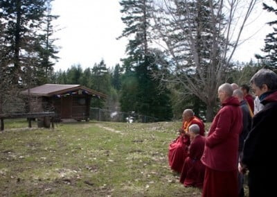 Rinpoche blesses the site for the teacher's cabin.