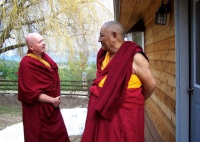 Venerable Steve and Rinpoche converse in front of Venerable's writing studio.
