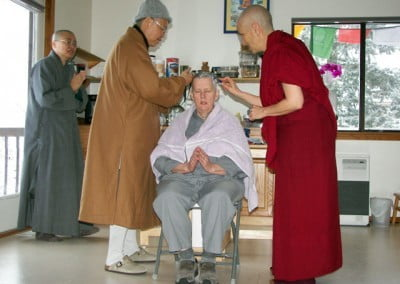 Dianne goes through the head shaving ceremony, the first step in her ordination.