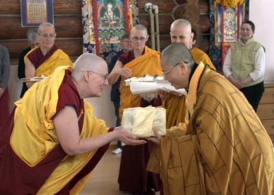Venerable Jigme makes offering to the bhikshunis.
