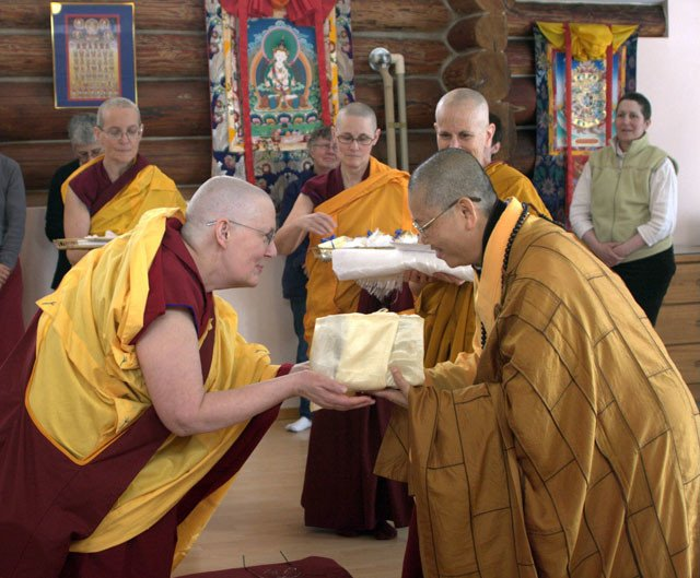 Venerable Jigme makes an offering to a Chinese nun while other monastics observe