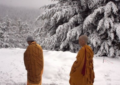The warmth of the golden robes against the cold, bright snow is a lovely sight as Bhikshuni Minjia and Bhikshuni Chodron proceed to the meditation hall.