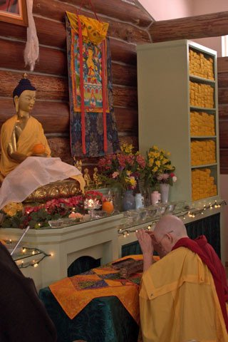 After the ordination ceremony, Dianne, now Venerable Thubten Jigme, offers incense to the Buddhas.