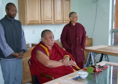 A door becomes an altar as Rinpoche blesses the new monastic residence.