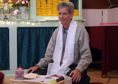 John Newman offers his translation skills. He has a calm and clear presence which is necessary when translating the Dharma.