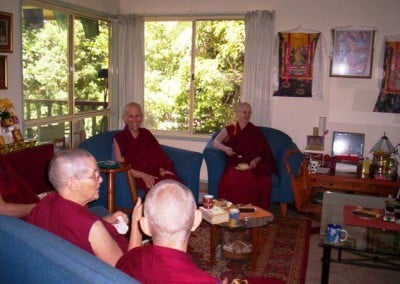 Venerable Chodron has tea with the nuns at Tashi House in one of Chenrezig Institute's community rooms.