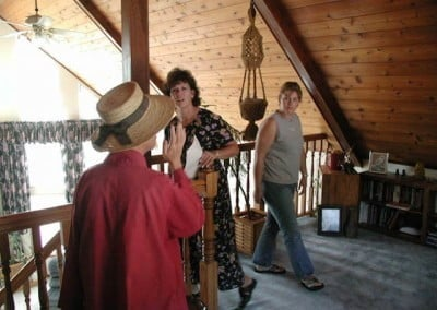 Venerable Chodron leads two women through the room above the living room of Ananda Hall