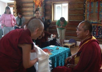 Venerable offers Geshe Damdul a khata