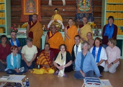 Some of the fortunate students who attended the teachings with Venerable  Chodron get their picture taken with Rinpoche.