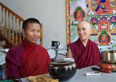 Venerable Chodron and Venerable Tsering Wangmo make a warm connection.