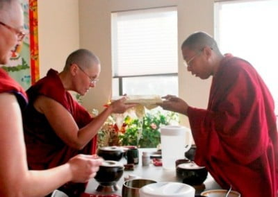 Venerable Chonyi makes an offering to Khenpo on behalf of the Abbey community.