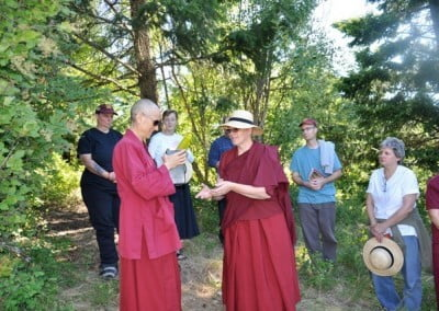 Venerable Yeshe helps Venerable Chodron open the box which contains his ashes.