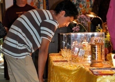 Young Dharma friend Luis peers into one of the relic cases.