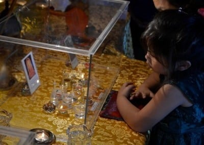 Children seem to have a natural curiosity and wonder about the relics.