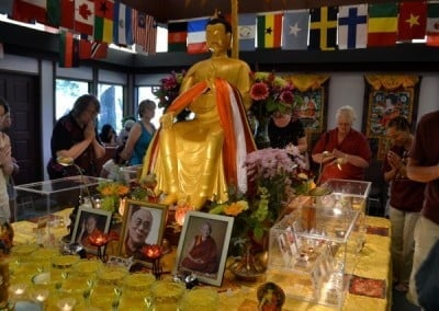 The statue of Maitreya, the future Buddha, sits in the center of the relics.