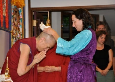 Louisa, one of the stewards of the relics, offers a relic blessing to Venerable Chodron.