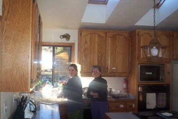 Nanc and Heather are in the kitchen doing  the daily clean up.