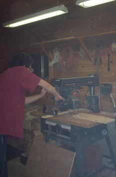A man working a large table saw