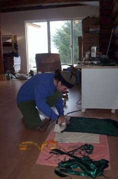 Heather, one of our local volunteers, has also remained busy during her stay. She has sanded the bookshelves, cleaned a large portion of the meditation hall (including the high windows) and made the curtains for the altar.