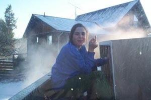 Woman sitting outside near the barn